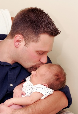 Dorset Fertility Home Page - man kissing baby